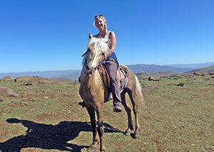 Anna horse riding in the Drakensburg Mountains